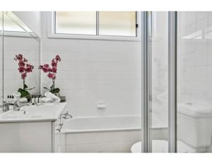 A bathroom at Modern Aus home on the edge of North Ryde Oval