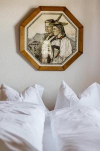 Ein Bett oder Betten in einem Zimmer der Unterkunft Landgasthof und Seminarhotel Lueg