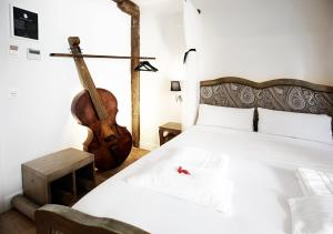 A bed or beds in a room at Basque Boutique