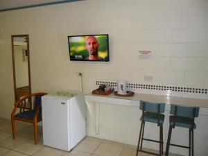 A television and/or entertainment center at Nanango Antler Motel