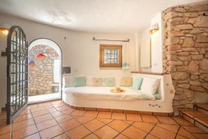 A bed or beds in a room at Villa Roccia