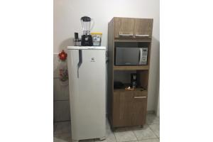 A kitchen or kitchenette at Próximo à PUC/UFRGS, Internet e Ar-Condicionado