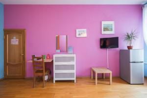 Телевизор и/или развлекательный центр в Italian Rooms Pio on Griboedova 35