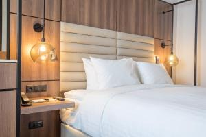 A bed or beds in a room at AC Hotel by Marriott Stockholm Ulriksdal
