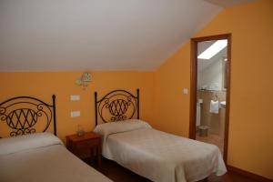 Cama o camas de una habitación en El Aposento De Babia