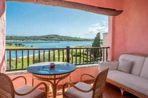 A balcony or terrace at Cala Di Volpe, a Luxury Collection Hotel