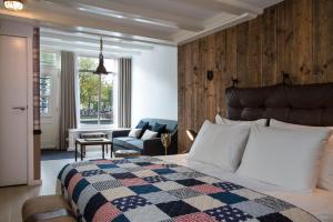 Un ou plusieurs lits dans un hébergement de l'établissement Max Brown Hotel Canal District
