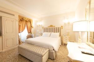 Un ou plusieurs lits dans un hébergement de l'établissement Ca' Bonfadini Historic Experience