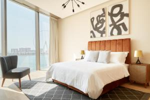 A bed or beds in a room at Sonder — JBR Suites