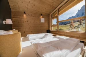 A bed or beds in a room at Rotwandwiesen Chalets SKI IN/OUT - 1900mt