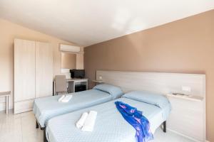Letto o letti in una camera di Hotel La Fattoria Sul Mare