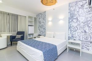 A bed or beds in a room at Ibis Styles RJ Botafogo