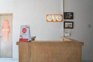 The lobby or reception area at OYO 1638 Cityzen Renon Hotel