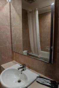 A bathroom at Karlita Hotel Tegal