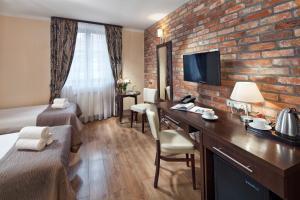 Telewizja i/lub zestaw kina domowego w obiekcie Hotel Bonum Old Town