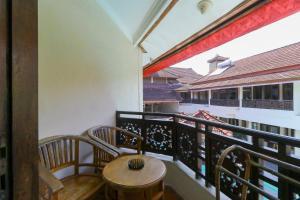 A balcony or terrace at The Flora Kuta Bali