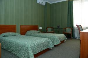 Кровать или кровати в номере Отель Юбилейный