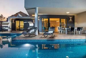 The swimming pool at or close to Villa Luce a luxury villa in Dubrovnik, tennis court