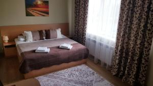 A bed or beds in a room at Chernivtsi Apartments