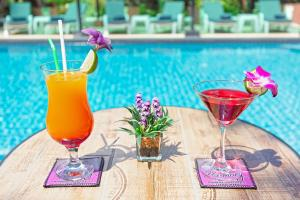 The swimming pool at or near Harmony Naturist Resort Rawai Phuket