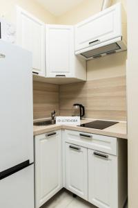A kitchen or kitchenette at OP Solntsevo Park