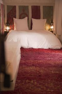 A bed or beds in a room at Dar El Qadi