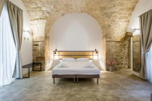 A bed or beds in a room at Scicli Albergo Diffuso