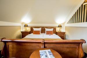 Un ou plusieurs lits dans un hébergement de l'établissement Hotel Diament Bella Notte Katowice - Chorzów