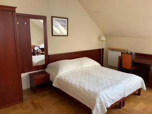 Łóżko lub łóżka w pokoju w obiekcie Willa Nova