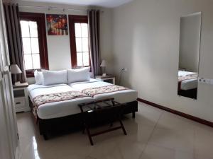 Cama ou camas em um quarto em Acoya Curacao Resort, Villas & Spa
