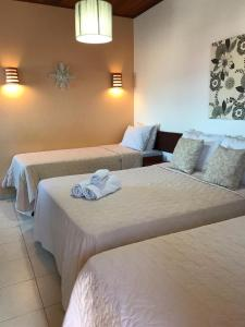 A bed or beds in a room at Pousada Morena