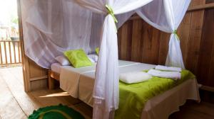 A bed or beds in a room at La Ceiba, Amazonas