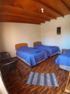 Cama ou camas em um quarto em Hostal Perita