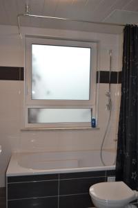 Ein Badezimmer in der Unterkunft Ferienwohnung Krone