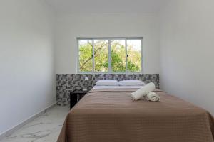 A bed or beds in a room at Casa de Férias Frente Mar em Canto Grande - 3 dorms 9 pessoas - Incrível Pôr do Sol