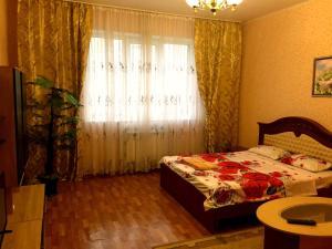 Кровать или кровати в номере Апартамент на Клыкова