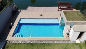A view of the pool at Casa dos Reis or nearby