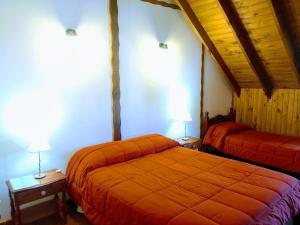Una cama o camas en una habitación de Lo de Guille