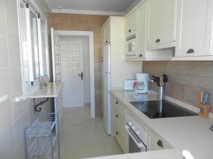 A kitchen or kitchenette at Rocamar, Nerja