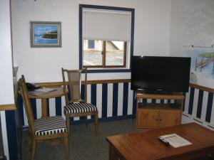 A television and/or entertainment center at Boyne City Motel