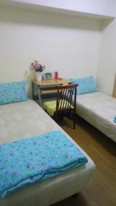 A bed or beds in a room at Residence Uni awaza 304