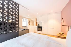 Ein Bett oder Betten in einem Zimmer der Unterkunft Hotel an der Aare Swiss Quality