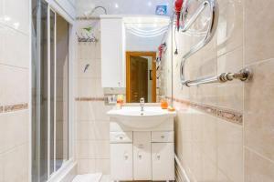 Ванная комната в Flat Near Bolshoi Theater