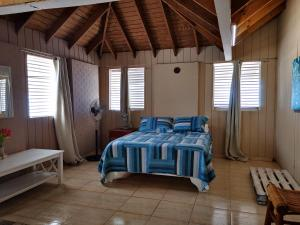 A bed or beds in a room at Saona Beach House