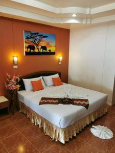 A bed or beds in a room at Ocean View Resort