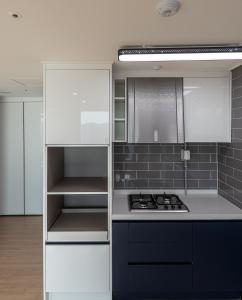 A kitchen or kitchenette at Biz House Apartment