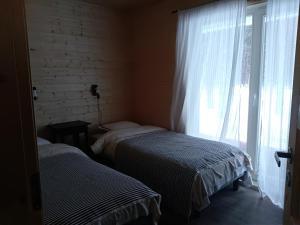 Voodi või voodid majutusasutuse Kauksi Puhkemaja toas