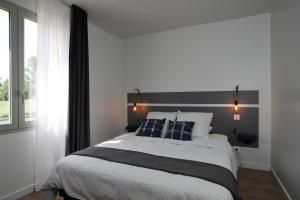 Un ou plusieurs lits dans un hébergement de l'établissement Le Clos Des Thermes De Jonzac