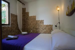 A bed or beds in a room at Apartment Podatok