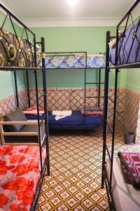 A bunk bed or bunk beds in a room at Hostel Kif-Kif